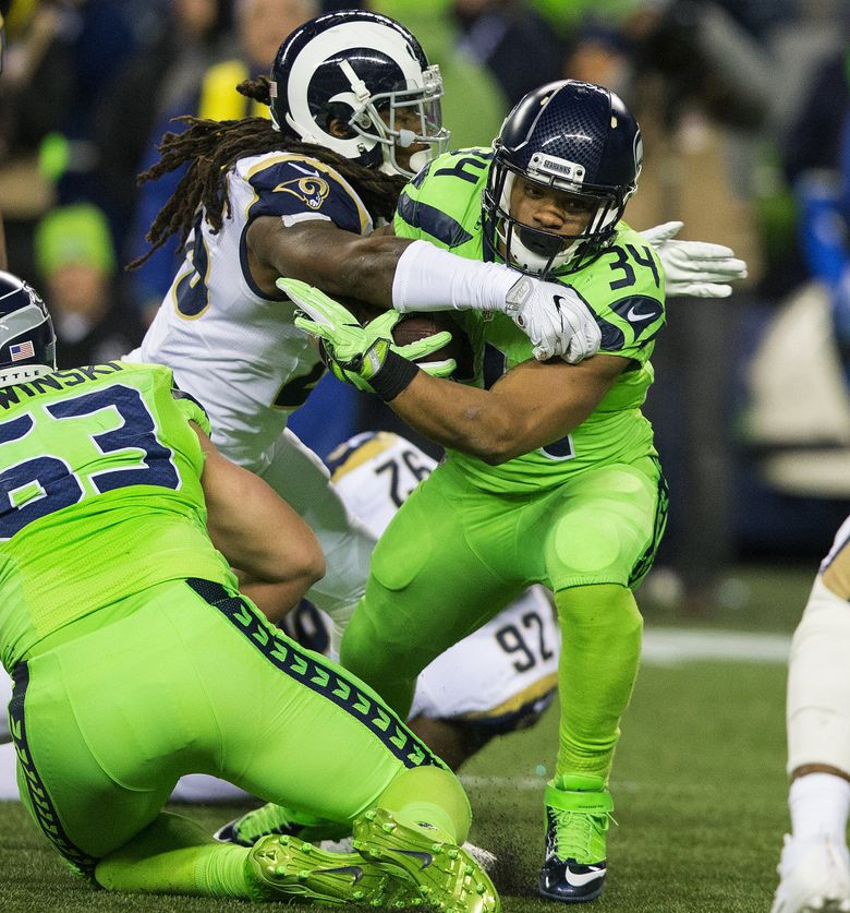 Seahawks running back Thomas Rawls is taken down in the backfield by a Rams defender. Rawls was held to 34 yards on 21 carries as Seattle struggled to get its running game going. (Mike Siegel/The Seattle Times)