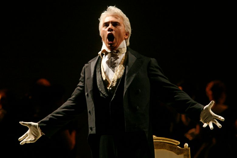 """FILE – In this Feb. 6, 2007 file photo, Dmitri Hvorostovsky performs during the final dress rehearsal for the opera """"Eugene Onegin"""" in New York.  Hvorostovsky has withdrawn from staged opera performance because of treatment for a brain tumor.   Hvorostovsky says in a statement Thursday, Dec. 8, 2016,  that """"I have been experiencing balance issues associated with my illness, making it extremely difficult for me to perform in staged productions.""""  (AP Photo/Shiho Fukada)"""