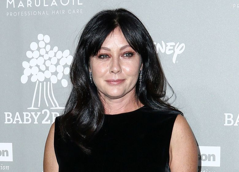 FILE – In this Nov. 14, 2015 file photo, Shannen Doherty attends the 4th Annual Baby2Baby Gala in Culver City, Calif. Doherty posted a photo on Instagram Dec. 13, 2016, of herself in a hospital gown alongside her mother as the actress undergoes radiation treatment for breast cancer. (Photo by John Salangsang/Invision/AP, File)