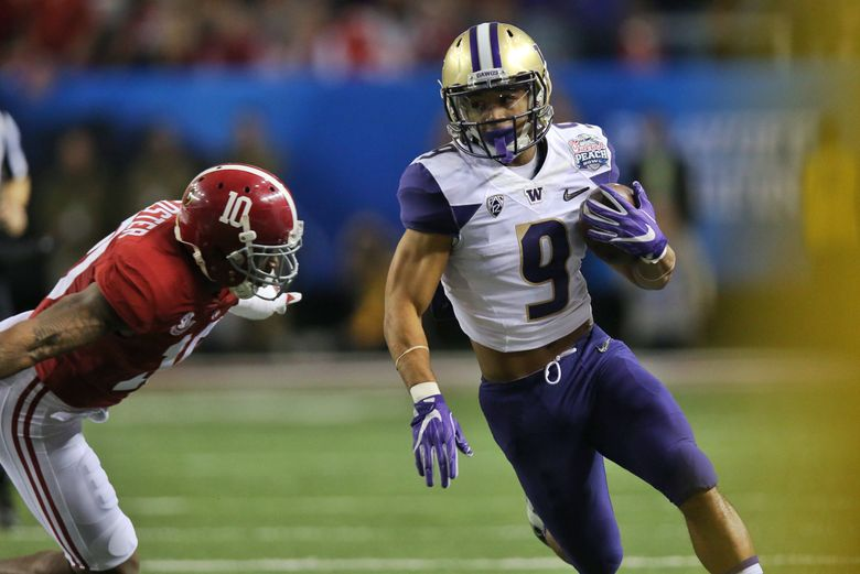 Washington running back Myles Gaskin rushes for a first down in the first quarter. The Washington Huskies faced off against the Alabama Crimson Tide at the Chick-fil-A Peach Bowl on Saturday, December 31, 2016, at the Georgia Dome in Atlanta. (Johnny Andrews/The Seattle Times)