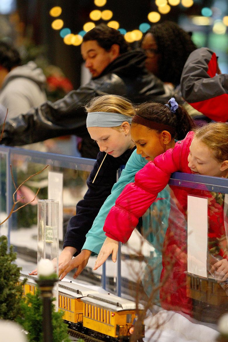 Kids try to get a closer look at a model train display as part of Winterfest at the Armory in Seattle Center on Dec. 5, 2015.  (John Lok / The Seattle Times)