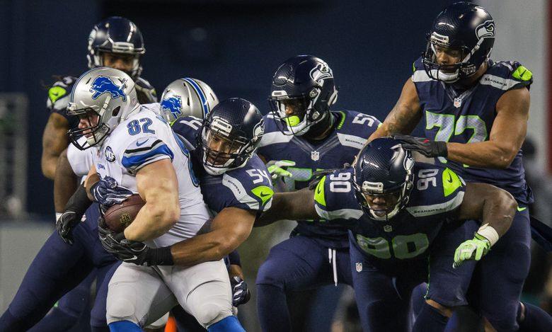 Defensively the Seahawks gave Detroit no quarter.  Bobby Wagner gets to Matthew Mulligan before the rest of his line can join in.  Wagner held Mulligan to a 2-yard loss on the play.   (Dean Rutz / The Seattle Times)