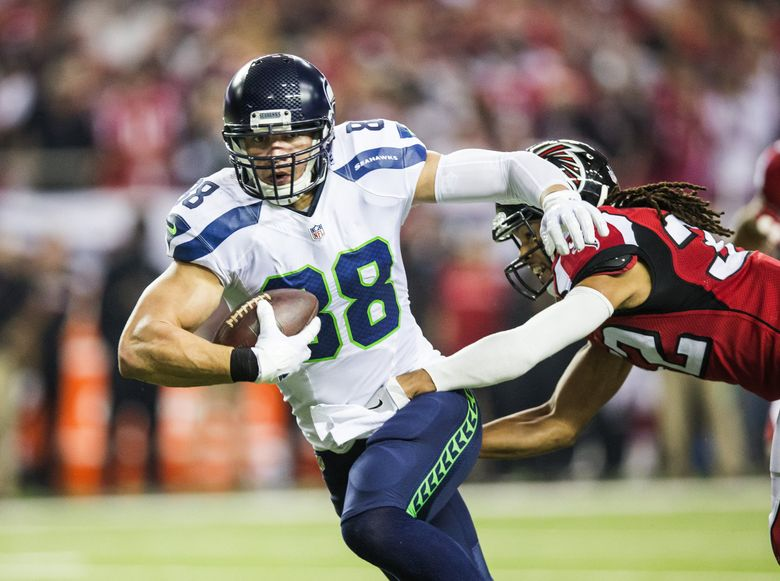 Jimmy Graham, shown here shaking off the tackle of Atlanta cornerback Jalen Collins in Saturday's playoff game, was added to the Pro Bowl roster Tuesday.  (Dean Rutz / The Seattle Times)