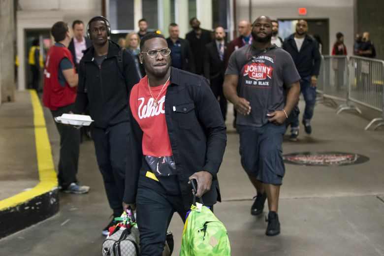 Seahawks defensive end Frank Clark walks in before the Seattle Seahawks take on the Atlanta Falcons in a playoff game in January.   (Bettina Hansen / The Seattle Times)