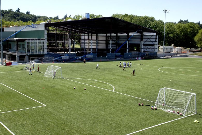 Fort Dent Park in Tukwila, shown in 2004 under construction, features a soccer camp with multiple artificial fields. (Dean Rutz/The Seattle Times)
