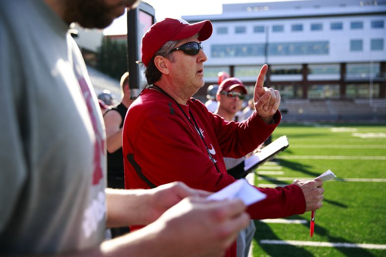 Head football coach Mike Leach watches practice at Washington State University Thursday, March 31, 2015.  (Erika Schultz / The Seattle Times)