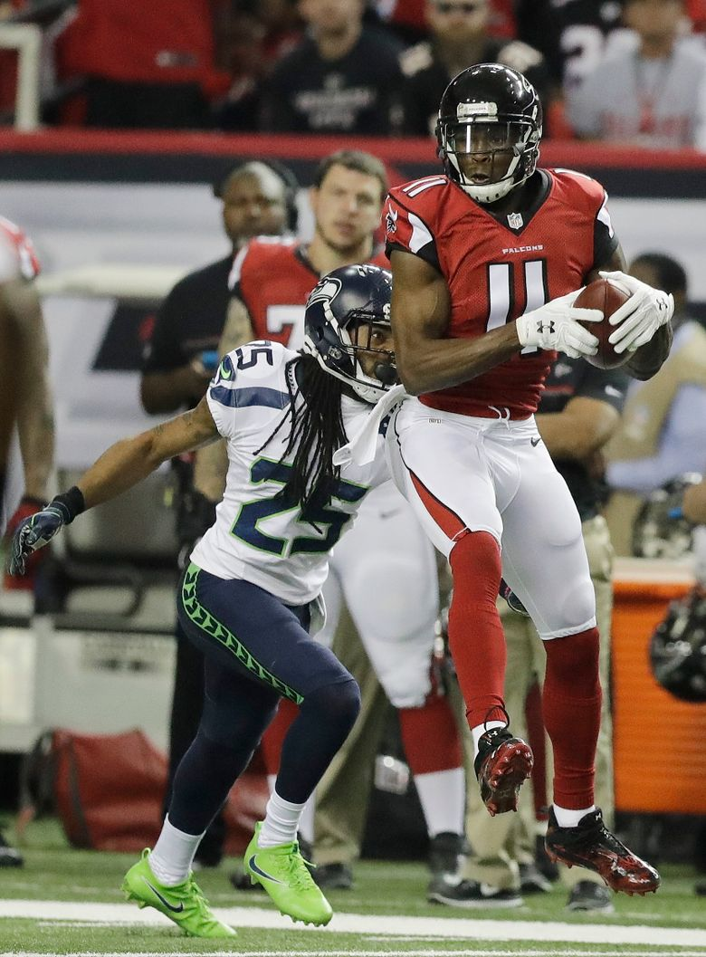 Atlanta Falcons wide receiver Julio Jones (11) makes the catch ahead of Seattle Seahawks cornerback Richard Sherman (25) during the first half of an NFL football NFC divisional playoff game, Saturday, Jan. 14, 2017, in Atlanta. (AP Photo/David Goldman)