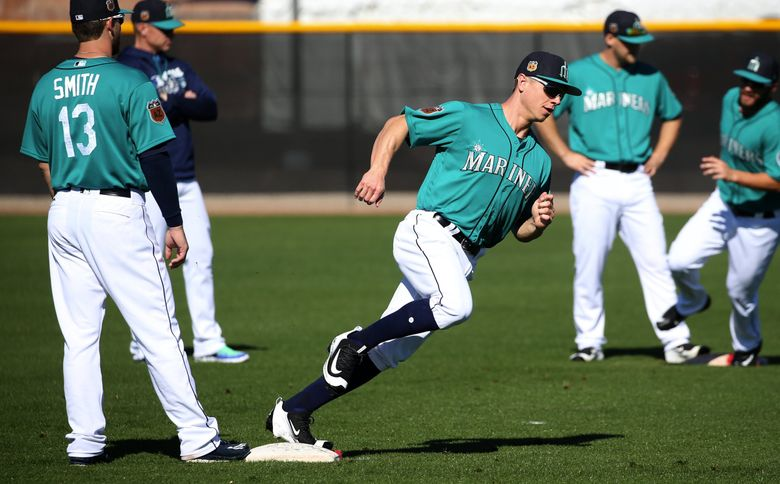 Mariners outfielder Tyler O'Neill does a base-running drill at spring training, Tuesday, Feb. 21, 2017, in Peoria, Ariz.  (Ken Lambert / The Seattle Times)