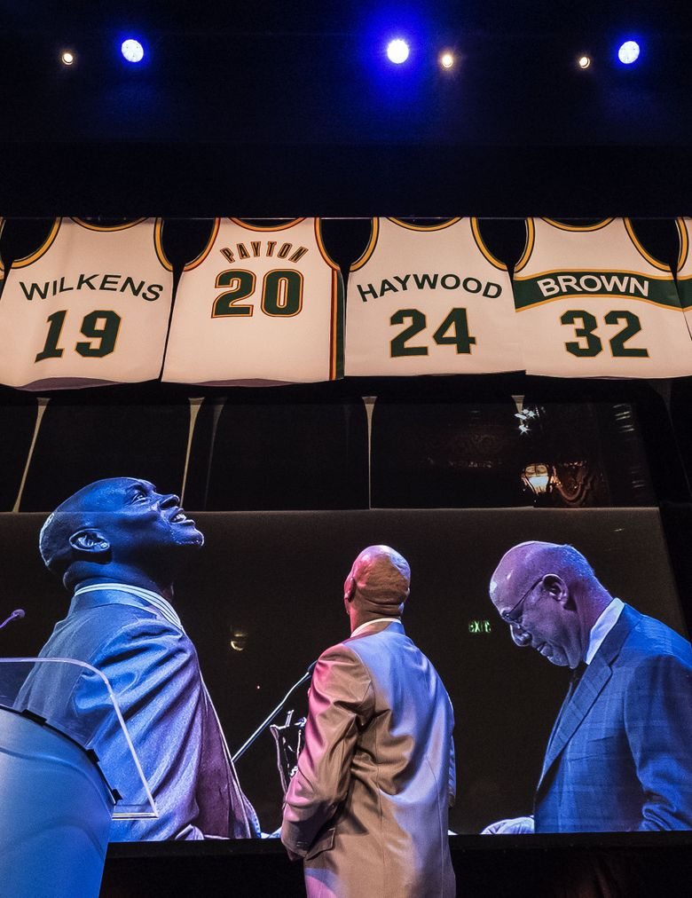 Former Sonics great Gary Payton has his jersey number honored at the 82nd annual sports awards Wednesday at the Paramount Theater, which honored top local male, female athletes and sports stories of the year. (Dean Rutz/The Seattle Times)