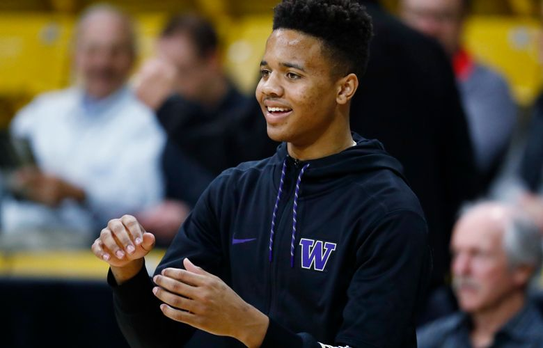 Washington guard Markelle Fultz looks for a pass from a teammate as they warm up before facing Colorado in an NCAA college basketball game Thursday, Feb. 9, 2017, in Boulder, Colo. Fultz, projected as a top pick in this year's NBA draft, is siting out the game. (AP Photo/David Zalubowski)