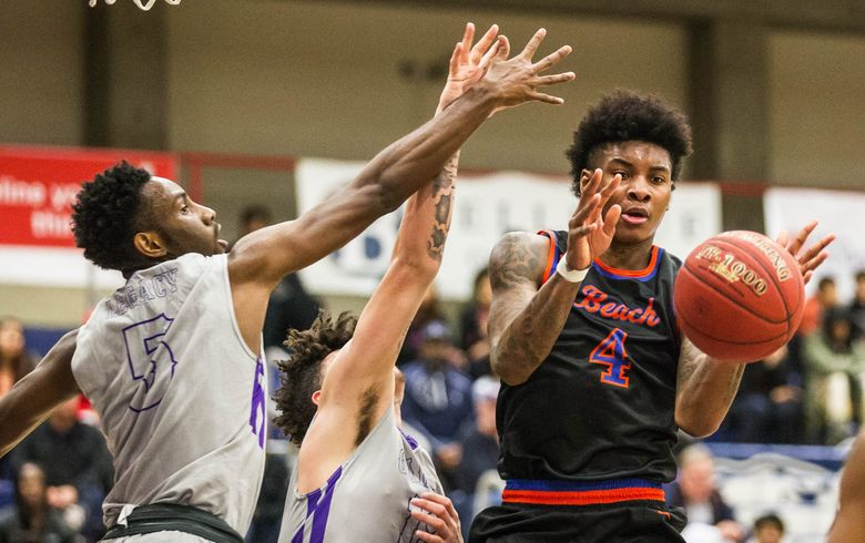 Rainier Beach's Kevin Porter Jr. (4) has averaged 20.5 points and 11 rebounds for the Vikings, who are looking to defend their Class 3A state championship. (Dean Rutz / The Seattle Times)