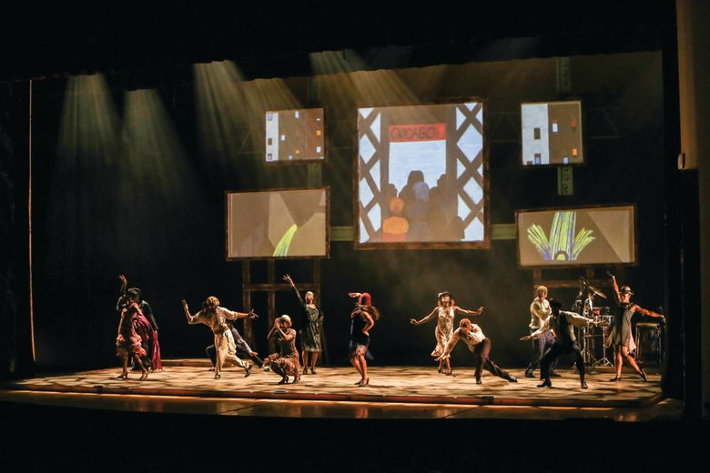"""Step Afrika! uses step dancing, and images from Jacob Lawrence's """"Migration Series,"""" to depict the mass movement of Southern blacks to the North. (Jati Lindsay) (JATI LINDSAY)"""