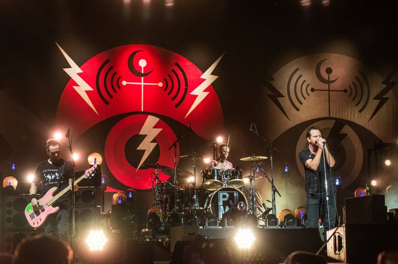 From left, Jeff Ament, Matt Cameron and Eddie Vedder of Pearl Jam perform at Bonnaroo Music and Arts Festival in 2016.  (Amy Harris/Invision/AP)