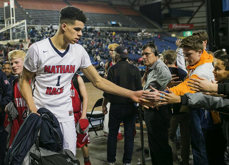 Michael Porter Jr. of Nathan Hale greets fans while walking off the court after his team's game against Stanwood on March 2, 2017. (Johnny Andrews / The Seattle Times)