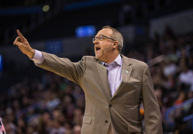 Mike Neighbors calls in the offensive play in the 2nd half.  The third-seeded Washington Huskies played two-seeded Mississippi State in the Sweet Sixteen of the women's NCAA Tournament Friday, March 24, 2017, at Chesapeake Arena in Oklahoma City.  (Dean Rutz / The Seattle Times)
