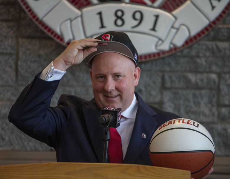 Thursday, March 30, 2017.  The new Seattle University head basketball coach, Jim Hayford tries on the SU hat after being introduced on campus.   201372