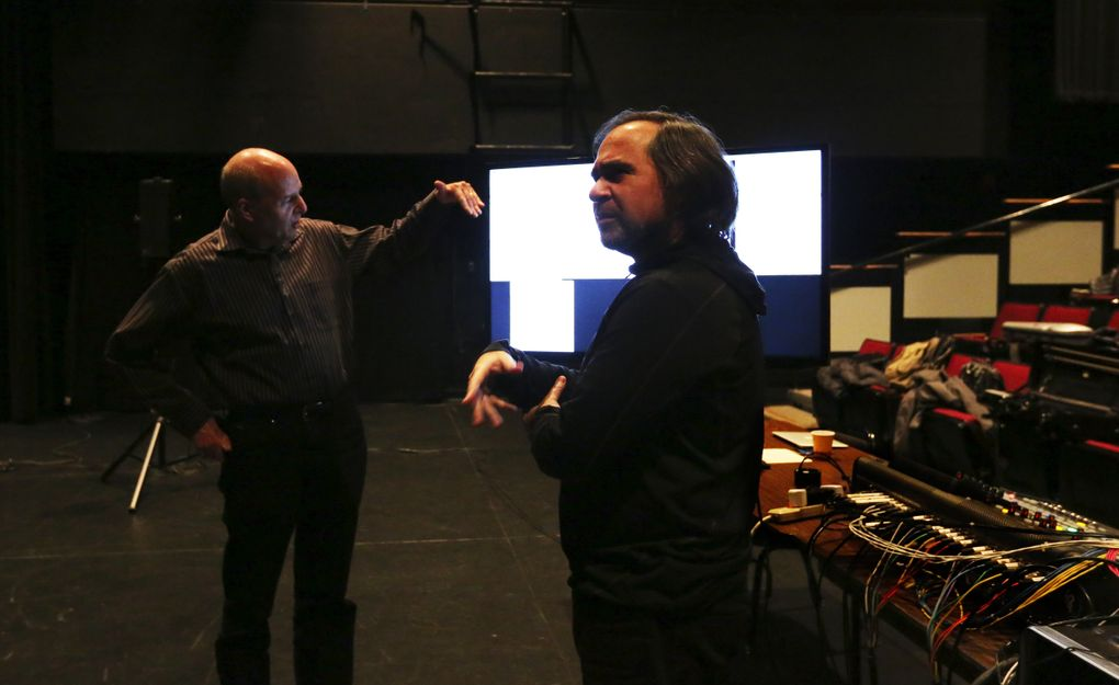 DXARTS co-founders Richard Karpen, left, and Juan Pampin discuss the musicians' brain waves during a rehearsal on the UW campus in Meany Studio Theater.  (Alan Berner/The Seattle Times)