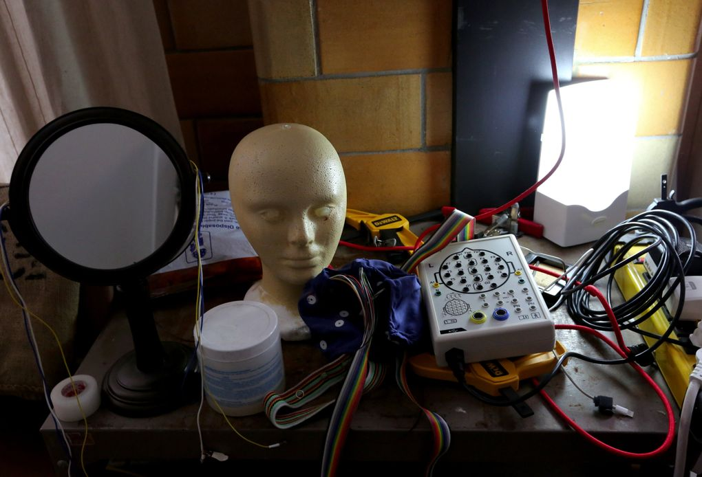 Every corner of neurologist and musician Thomas Deuel's studio has surprises, old and new. The white electronic box connects to the electrode cap. It's an amplifier from St. Petersburg, Russia, and when it needs repair, it's back to St. Petersburg.  (Alan Berner/The Seattle Times)