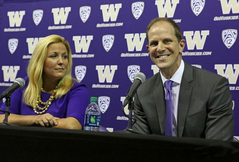 University of Washington Athletic Director Jennifer Cohen and basketball coach Mike Hopkins. (Ken Lambert/The Seattle Times)
