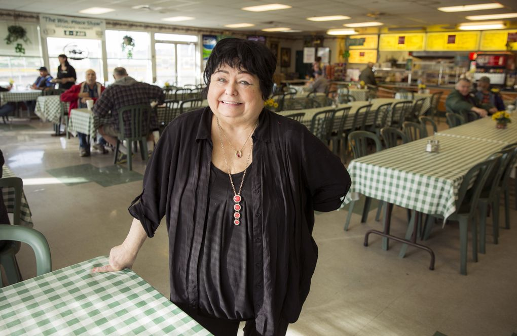 """Sally Steiner, 71, and her husband Joe Steiner Sr. own and operate the Quarter Chute Caf at Emerald Downs, which they say is the only public kitchen at a racetrack in the country. The Quarter Chute is the hub of all of the action between the track and the stables, and Steiner is at the heart of it all, and knows practically everyone. Her father was a jockey and their children are also in the business. """"These are the people that I've grown up with, and my heart is here,"""" Steiner said. """"We celebrate together, we cry together, and we pray together."""" (Bettina Hansen/The Seattle Times)"""