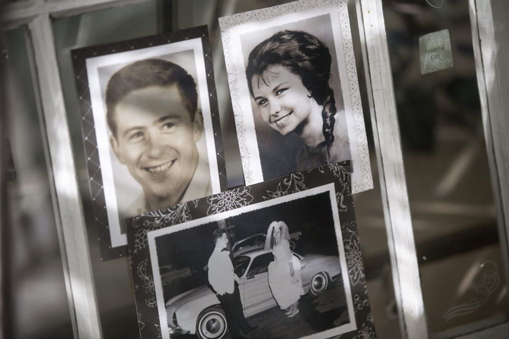 Old photos of Sally Steiner, right, and her husband Joe Steiner Sr. hang up in the Quarter Chute Cafe, which they own and operate at Emerald Downs. (Bettina Hansen/The Seattle Times)