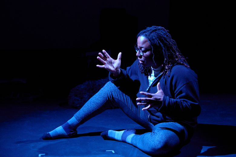 """Jhan 'sanyn performs in """"Yankee Pickney,"""" her raw and unexpectedly funny solo show at Theater Schmeater about coming of age as a """"white-people black"""" daughter of Caribbean immigrants. (Dave Hastings)"""