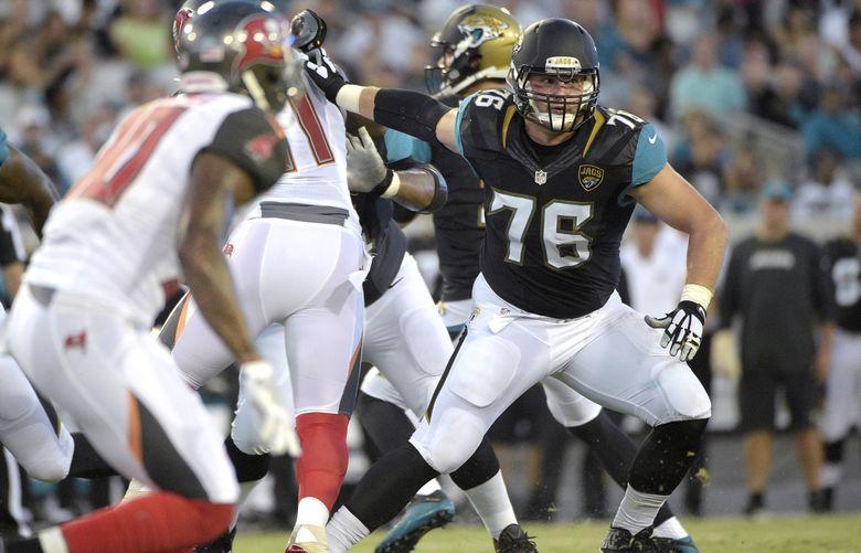 Jacksonville Jaguars tackle Luke Joeckel (76) blocks during the first half of an NFL preseason football game against the Tampa Bay Buccaneers in Jacksonville, Fla., Saturday, Aug. 20, 2016. (AP Photo/Phelan M. Ebenhack)