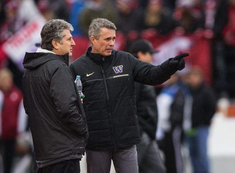 Washington State head coach Mike Leach and Washington head coach Chris Petersen talk before the 109th Apple Cup at Martin Stadium in Pullman on Friday, Nov. 25, 2016. (Lindsey Wasson/The Seattle Times)