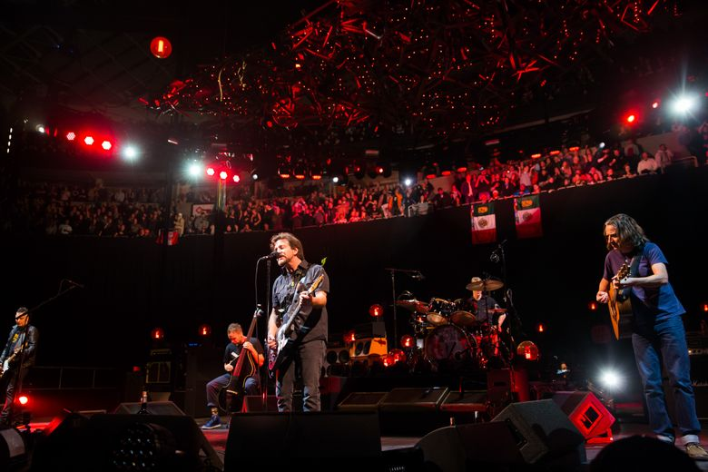 The band Pearl Jam led by Eddie Vedder, middle, performs at KeyArena in Seattle, on Friday, Dec. 6, 2013.  (Marcus Yam / The Seattle Times)