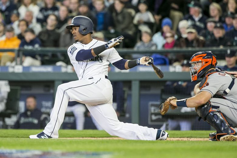 Mariners shortstop Jean Segura advances Mariners catcher Mike Zunino to third in the third inning as the Seattle Mariners take on the Houston Astros for their home opener for the 2017 season Monday April 10, 2017.