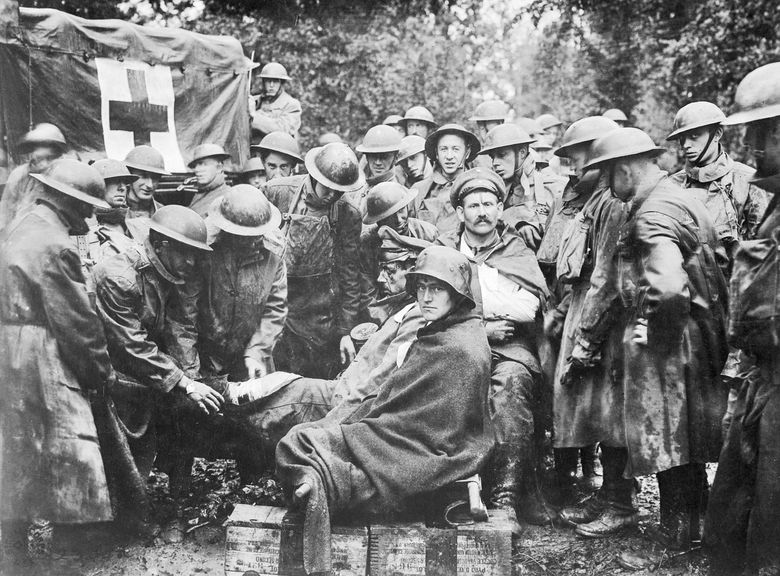 """American soldiers tending to German prisoners during World War I. PBS' """"American Experience"""" will feature, """"The Great War,"""" a three-part series about World War I premiering next Monday. (PBS)  1199939 1199939"""
