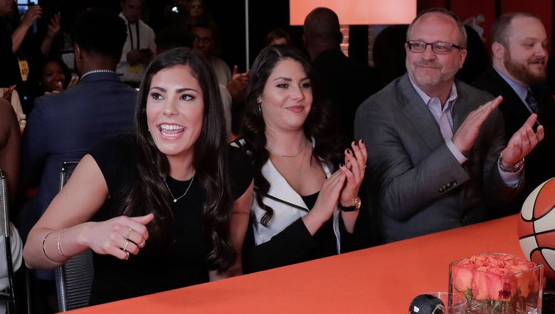 Kelsey Plum, left, reacts after being announced as the No. 1 pick in the WNBA draft by the San Antonio Stars, Thursday. No college athlete has seen a month like the UW standout has seen. (Julie Jacobson/AP)
