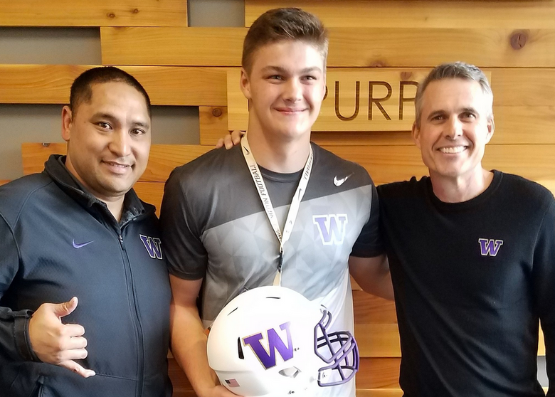 Draco Bynum, a 6-foot-5, 250-pound defensive end from Wilsonville, Ore., poses with UW coach Chris Petersen (right) and defensive line coach Ikaika Malloe at the UW football offices. (Via Twitter @DracoBynum)