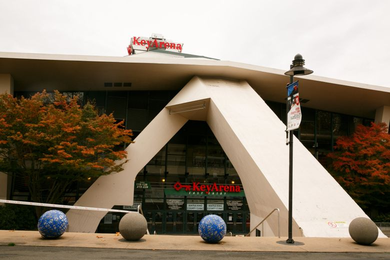Both KeyArena renovation groups are seeking varying degrees of public funding to offset the massive costs of building their projects without first securing teams. (Erika Schultz / The Seattle Times)