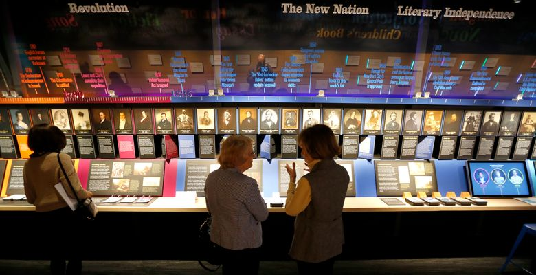 """Visitors to the American Writers Museum look at a timeline display that celebrates authors who are emblematic of """"American Voices.""""  (Charles Rex Arbogast/The Associated Press)"""