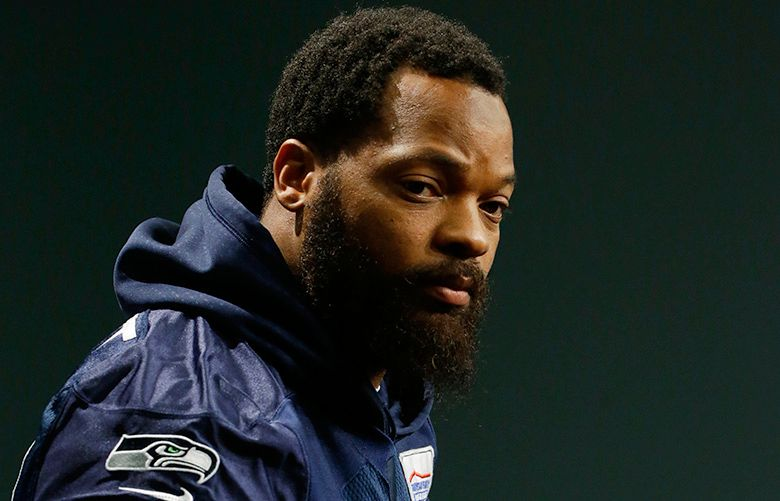 Seattle Seahawks defensive end Michael Bennett listens to a question as he talks to reporters, Tuesday, Jan. 10, 2017, in Renton, Wash. The Seahawks will play the Atlanta Falcons in an NFL football NFC playoff game, Saturday, Jan. 14, 2017 in Atlanta (AP Photo/Ted S. Warren)