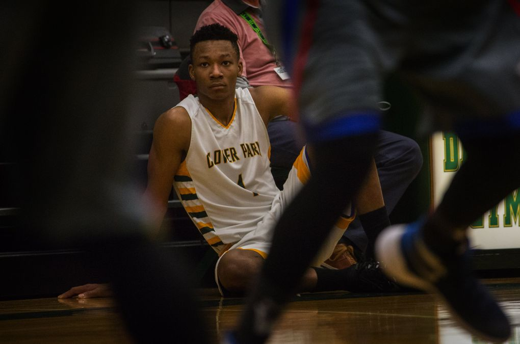 Clover Park High School basketball player Semaj Booker (#1) watches the action shortly before he goes back in at the Clover Park Warrior's playoff game against the Washington Patriots at Foss High School in Tacoma, WA, Monday, February 15, 2016.  (Ellen M. Banner/The Seattle Times)