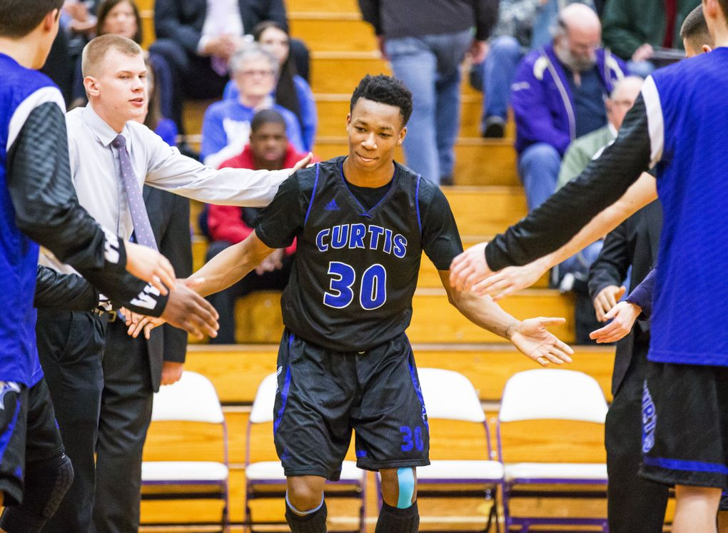 Curtis HS forward Semaj Booker is introduced at the start of a district playoff game with Federal Way. (DEAN RUTZ / The Seattle Times)