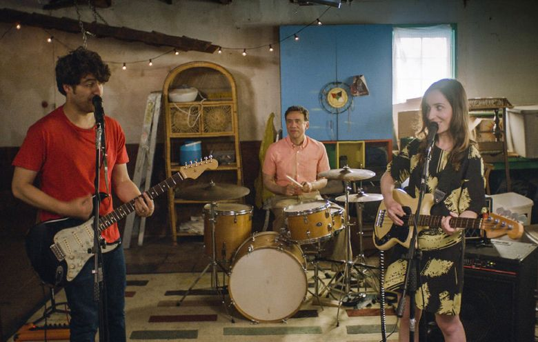 """A married couple (Adam Pally, left, and Zoe Lister-Jones) play out their fights through song, with the help of their neighbor (Fred Armisen), in """"Band Aid."""" (Courtesy of SIFF)"""