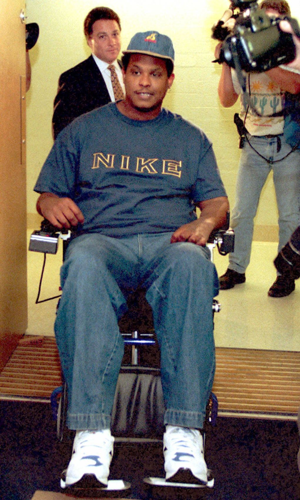 Mike Frier maneuvers his wheelchair before a news conference at the UW Medical Center in Seattle. The former Seahawks defensive lineman spoke for the first time since a Dec.1,1994 accident left him paralyzed. (GARY STEWART/Associated Press)
