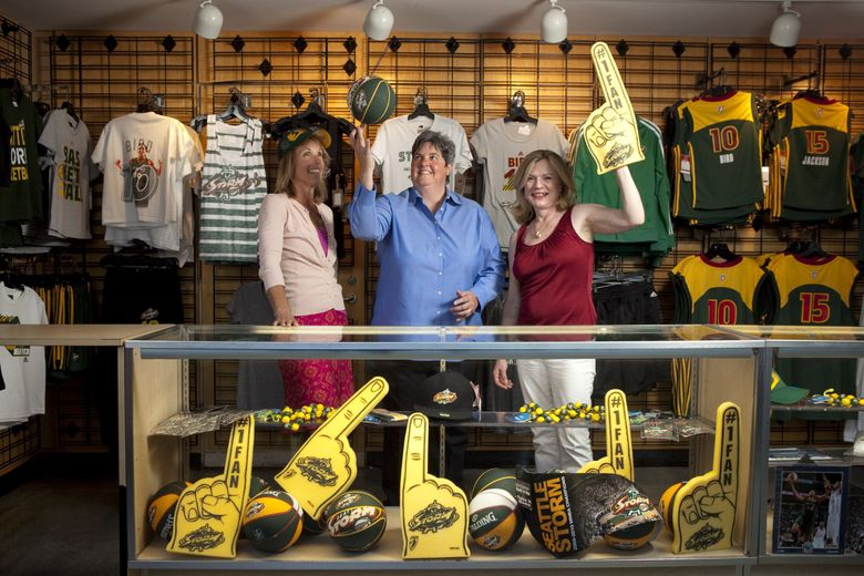 From left, Ginny Gilder, Lisa Brummel, and Dawn Trudeau pose for a portrait in one of the team shops at Key Arena before the Seattle Storm take on the Phoenix Mercury Thursday August 16, 2012. Brummel, Gilder and Trudeau form the ownership group Force 10 Hoops, that owns the Seattle Storm. (Bettina Hansen, The Seattle Times)