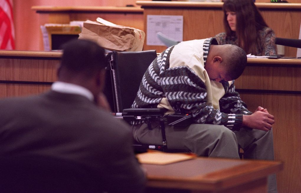 Former Seahawks running back Lamar Smith, back to camera, sits watching Mike Frier, who was waiting for more questions while testifying in court. (Steve Ringman/The Seattle Times)