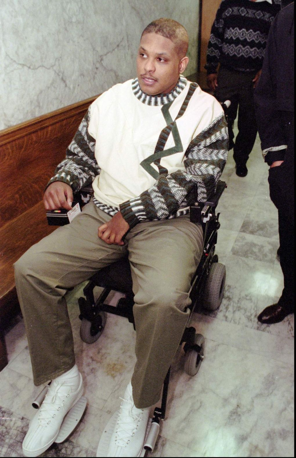 Mike Frier arrives at Superior Court in Seattle in 1996. Frier testified against former teammate Lamar Smith, who was charged with vehicular assault in the Dec. 1, 1994, accident that paralyzed Frier. (ROBERT SORBO/AP)