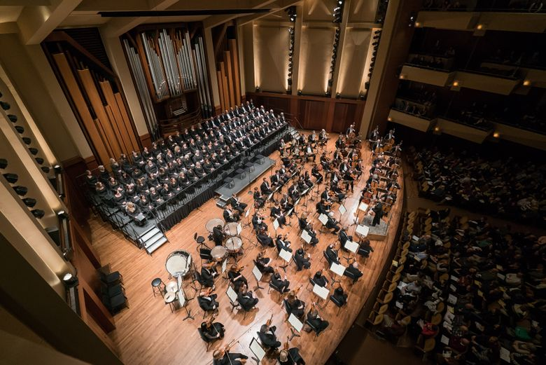 The Seattle Symphony (shown with Seattle Symphony Chorale) will close its season with a concert of Ligeti's Requiem and Mahler's Fifth Symphony. (Brandon Patoc)