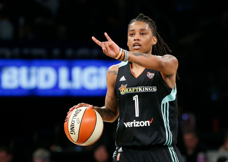 """FILE – In this June 7, 2017 file photo, New York Liberty guard Shavonte Zellous (1) gestures in the second half of an WNBA basketball game against the Atlanta Dream in New York. Zellous is thrilled that the New York Liberty will have a float in Sunday's pride parade, the first for a sports franchise in the city. """"I'm excited. I haven't been in a pride parade before, so I think I'm more excited than most,"""" said Zellous, a guard who wore rainbow-colored shoes Friday night, June 23 for the Liberty's pride game. (AP Photo/Kathy Willens, File)"""