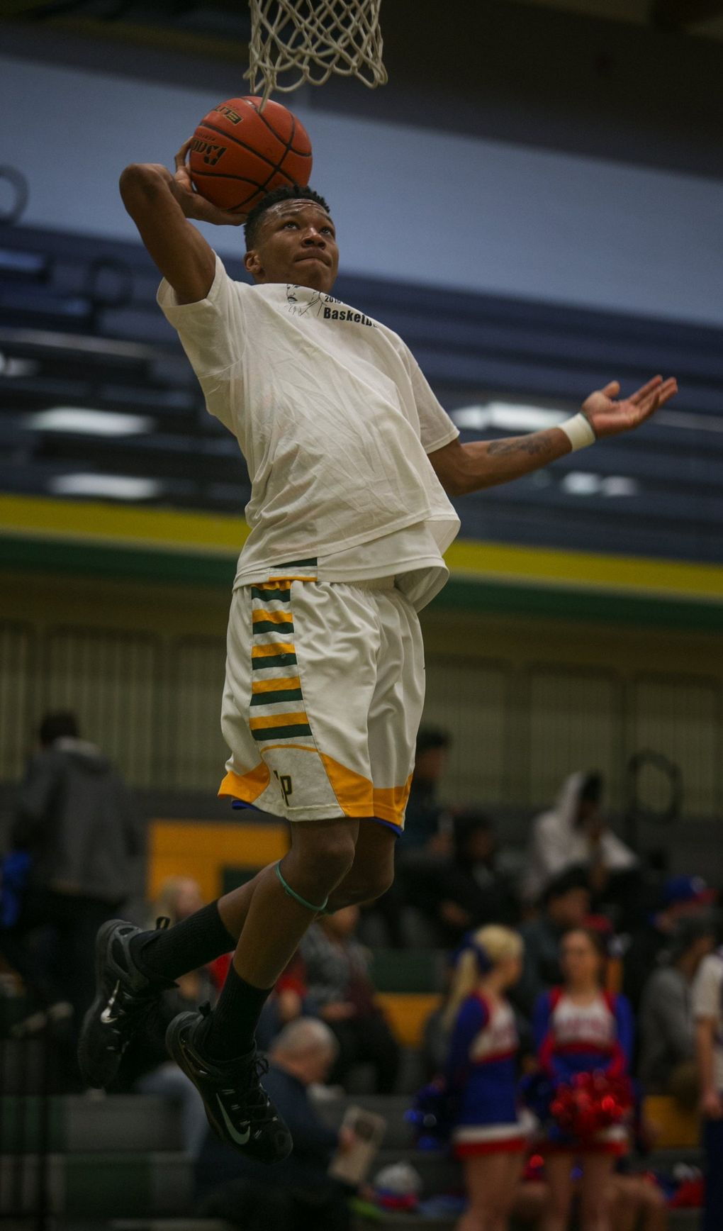 Clover Park High School basketball player Semaj Booker goes up for a basket before playing in the Clover Park Warrior's playoff game against  the Washington Patriots  at Foss High School in Tacoma, WA, Monday, February 15, 2016. (Ellen M. Banner / The Seattle Times)