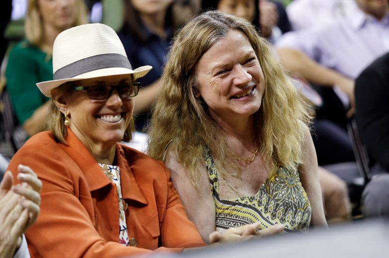 Two of three Seattle Storm owners Ginny Gilder, left, Dawn Trudeau, smile as they look on at a news conference Thursday, April 21, 2016, in Seattle. (Elaine Thompson/AP)