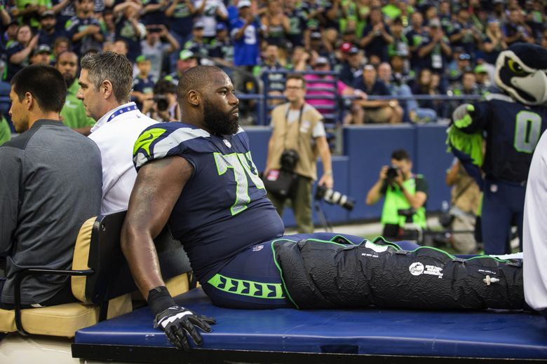 George Fant is carted off the field with a knee injury in the 2nd quarter. The Minnesota Vikings played the Seattle Seahawks in preseason football Friday at CenturyLink Field in Seattle. (Dean Rutz / The Seattle Times)