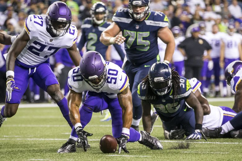 Vikings linebacker Eric Wilson picks up a fumble by Seahawks running back Alex Collins near the goal line in the fourth quarter as Seattle takes on the Minnesota Vikings for a preseason game at CenturyLink Field in Seattle Friday.  (Bettina Hansen / The Seattle Times)