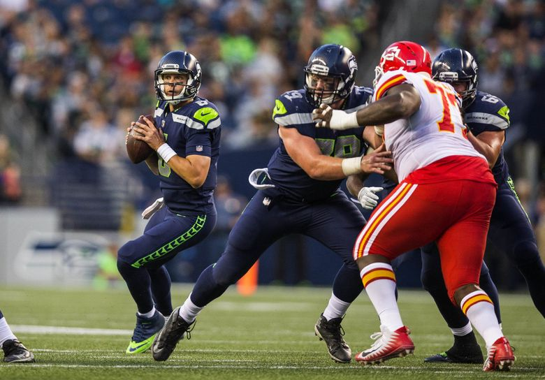 Quarterback Austin Davis gets the time, and spots up Tanner McEvoy on the right side, hitting him for a 28-yard touchdown in the 4th quarter of a preseason game in 2017. (Dean Rutz / The Seattle Times)